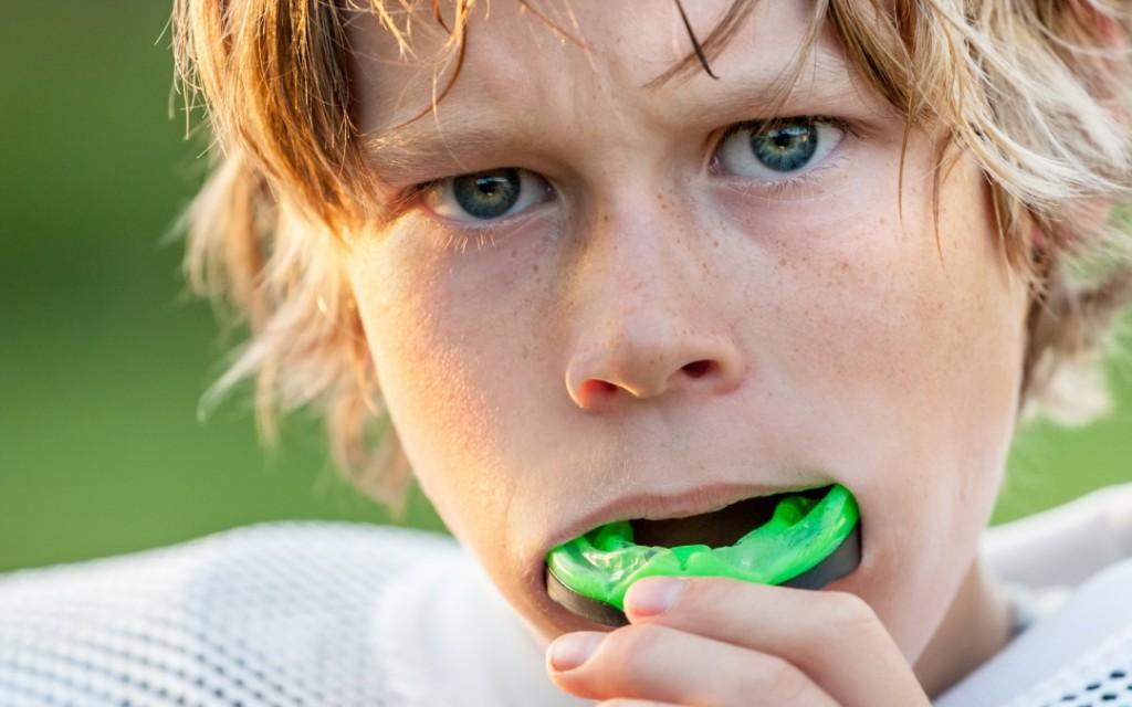 child wearing mouthguard